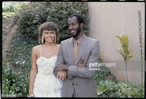 Laguna Hills California Olympic hurdler Edwin Moses who holds the world record on the 400meter hurdles poses with his new wife Myrella Bordt 6/2 in...