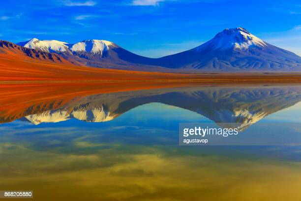 Laguna Lejia – dramatic Lejia lake mirrored reflection at gold colored sunrise dawn, snowcapped Lascar volcano and volcanoes, Idyllic Atacama Desert, Volcanic landscape panorama – San Pedro de Atacama, Chile, Bolívia and Argentina border