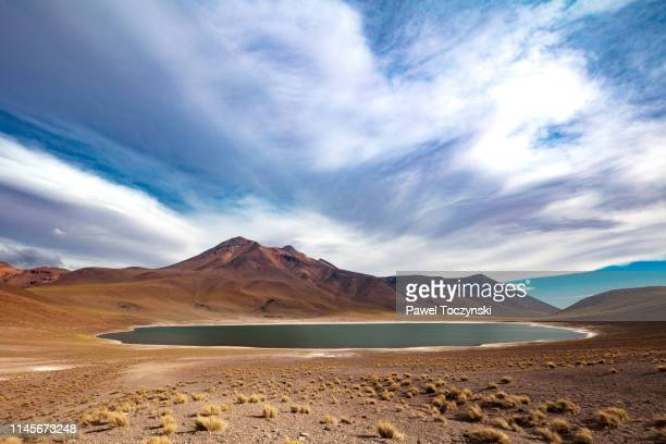 laguna miñiques located in atacama desert at 4,140m altitude, chile, january 19, 2018 - volcanic terrain stock pictures, royalty-free photos & images