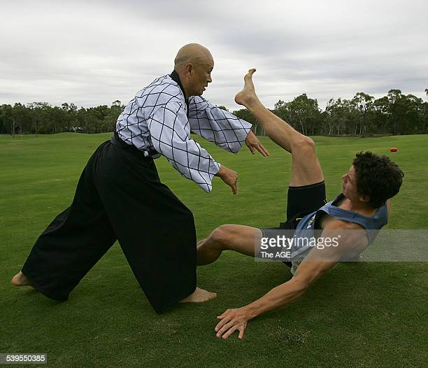 Laguna Whitsundays Queensland Grand master YongSup Kimm puts Richmond's Troy Simmonds through his moves on 22nd June 2005 THE AGE SPORT Picture by...