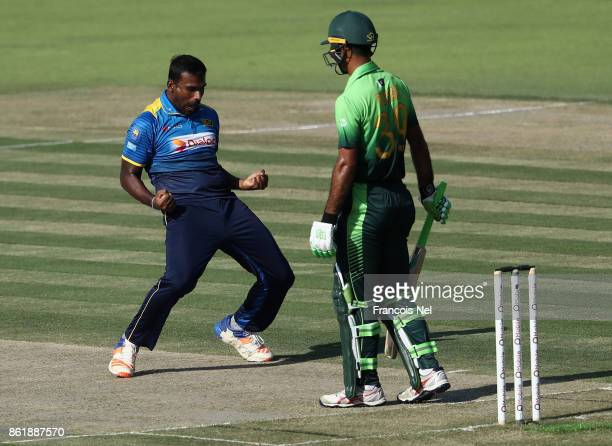 Lahiru Gamage of Sri Lanka celebrates after dismissing Fakhar Zaman of Pakistan during the second One Day International match between Pakistan and...