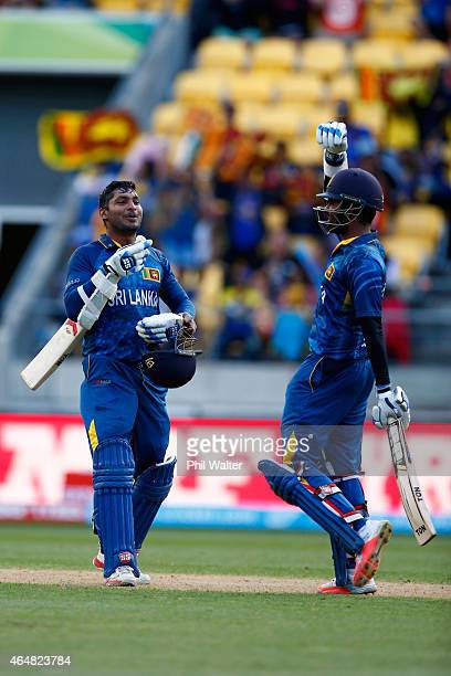 Lahiru Thirimanne and Kumar Sangakkara of Sri Lanka celebrate their win during the 2015 ICC Cricket World Cup match between England and Sri Lanka at...