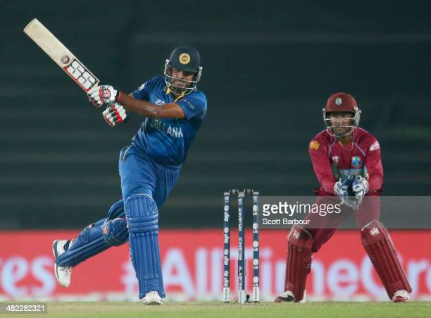 Lahiru Thirimanne of Sri Lanka bats as Denesh Ramdin of the West Indies looks on during the ICC World Twenty20 Bangladesh 2014 1st SemiFinal match...