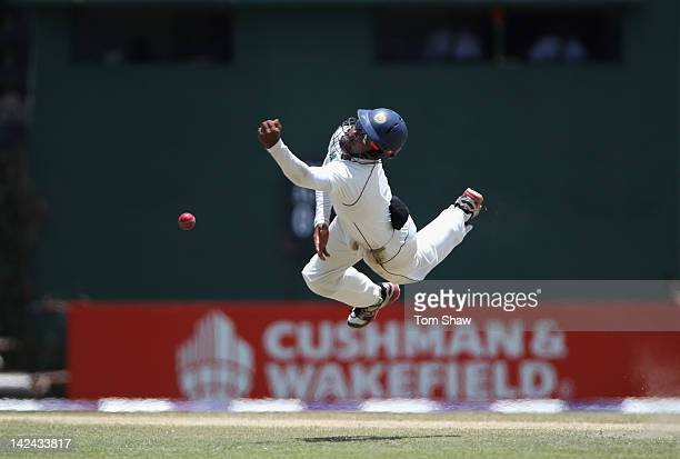 Lahiru Thirimanne of Sri Lanka dives in vain off a chance from Kevin Pietersen of England during day 3 of the 2nd test match between Sri Lanka and...