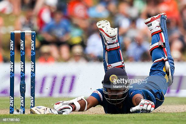 Lahiru Thirimanne of Sri Lanka dives to make his ground during the One Day International match between New Zealand and Sri Lanka at Saxton Field on...