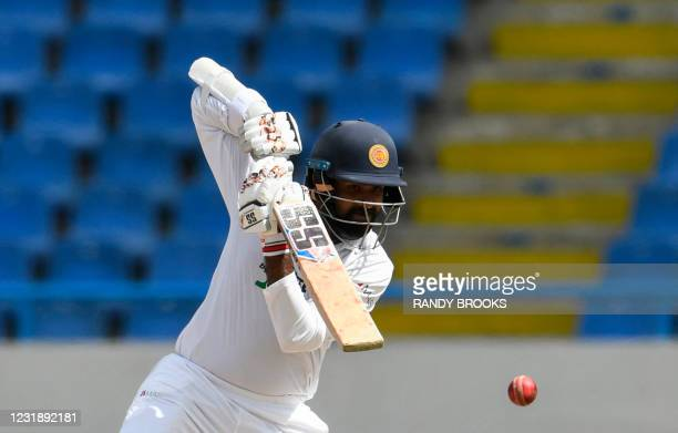 Lahiru Thirimanne of Sri Lanka hits a 4 during day 3 of the 1st Test between West Indies and Sri Lanka at Vivian Richards Cricket Stadium in North...