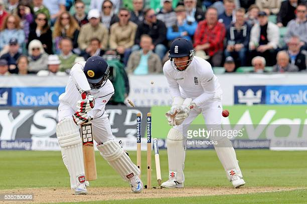 Lahiru Thirimanne of Sri Lanka is clean bowled by Moeen Ali during day three of the 2nd Investec Test match between England and Sri Lanka at Emirates...