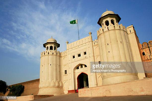 lahore fort, pakistan - pakistani flag stock photos and pictures