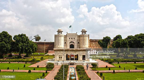 lahore fort - pakistani flag stock photos and pictures