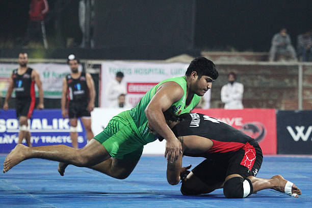 Lahore Lions compete against Punjab Thunder during the 2014 World Kabaddi league tournament at Punjab Agricultural University Hockey Stadium on...