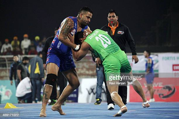 Lahore Lions compete against United Singhs during the 2014 World Kabaddi league tournament at Punjab Agricultural University Hockey Stadium on...