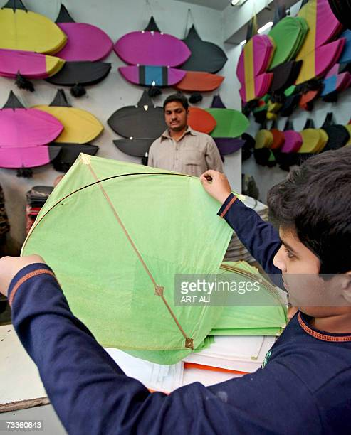 A Pakistani child selects a kite at a kite shop in Lahore 18 February 2007 on the eve of The Basant Festival Pakistani authorities have lifted a ban...