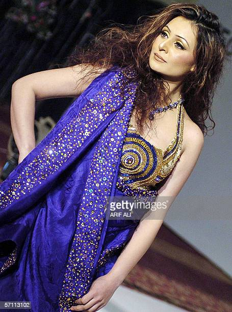 A Pakistani model displays a creation by Islamabadbased young designer Amna Malik during a fashion show in Lahore 17 March 2006 The event was...