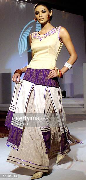 A Pakistani model displays an outfit during a fashion show in Lahore 16 March 2006 The event was organised by the Dubaibased Kamber Entertainment...