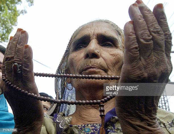 A Pakistani woman activist of the opposition Alliance for Restoration of Democracy offers prayers for rebel tribal chief Nawab Akbar Bugti who was...