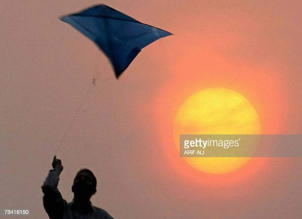 A Pakistani youth enjoys flying kite during the Basant or kite flying festival in Lahore 25 February 2007 Basant a festival of colours and kites...