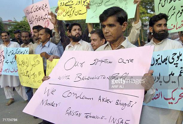 Activists of Pakistan TehreekeInsaf party hold placards during a demonstration in Lahore 27 August 2006 held to protest against the killing of tribal...