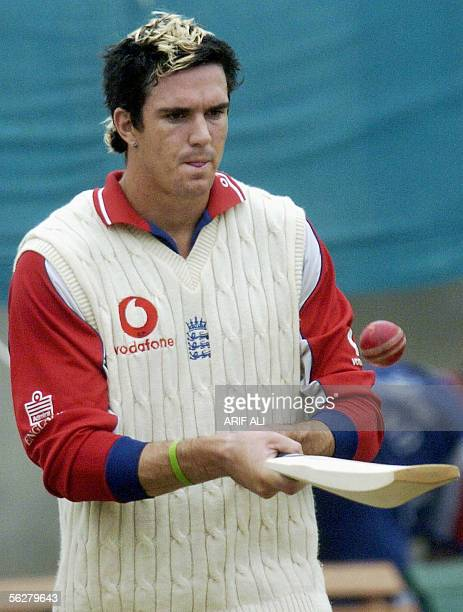 England cricketer Kevin Pietersen plays with a ball during a practice session at The Gaddafi Cricket Stadium in Lahore, 27 November 2005. Pakistan...