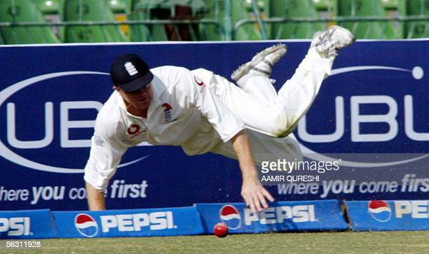 England cricketer Shaun Udal successfully stops the ball before it crosses the boundary during the third day of the third and final Test match...