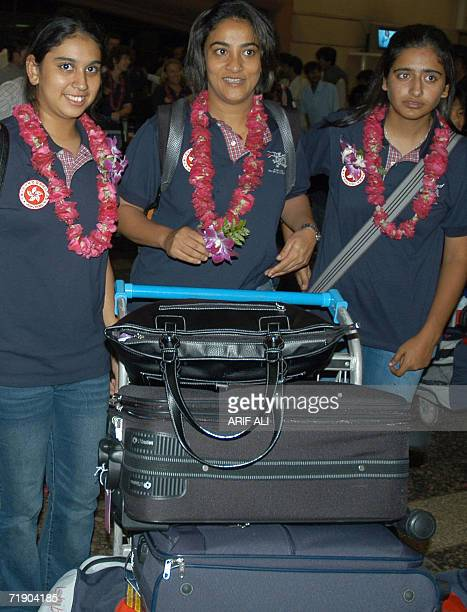 Hong Kong women cricketers arrive at Allama Iqbal International airport in Lahore late 15 September 2006 Neisha Pratt leads a determined batch of...