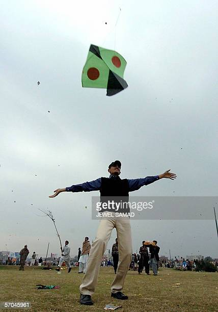 In this picture taken 06 February 2005 Pakistani youths enjoy flying kites during the Basant or kite flying festival in Lahore Pakistan's eastern...