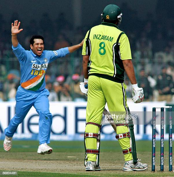 Indian cricketer Sachin Tendulkar leaps into the air as he celebrates taking the wicket of Pakistani captain InzamamulHaq during the third One Day...