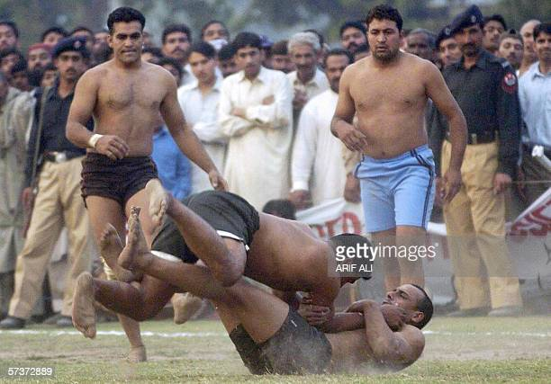 Indian Punjab Kabaddi player Mangat Singh captures his Pakistani Punjab opponent during a Kabaddi match between Pakistan and India at The Attiq...