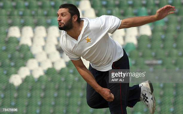 Pakistani cricketer Shahid Afridi delivers a ball at the Gaddafi Cricket Stadium in Lahore 26 February 2007 during a practice match in preparation...