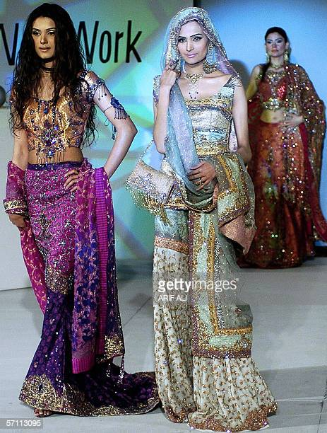 Pakistani models display bridal dresses by Islamabadbased young designer Amna Malik during a fashion show in Lahore 17 March 2006 The event was...