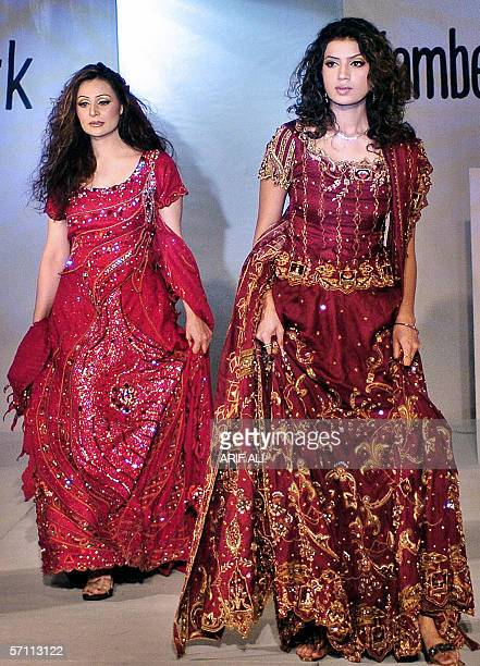 Pakistani models display bridals dresses by Islamabadbased young designer Amna Malik during a fashion show in Lahore 17 March 2006 The event was...