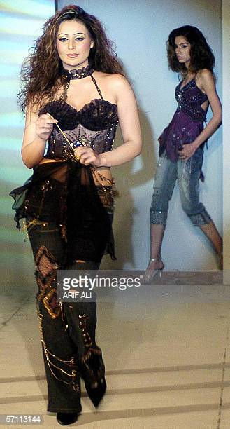 Pakistani models display creations by Islamabadbased young designer Amna Malik during a fashion show in Lahore 17 March 2006 The event was organised...