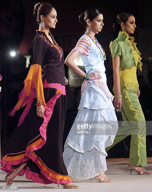 Pakistani models display outfits during a fashion show in Lahore 16 March 2006 The event was organised by the Dubaibased Kamber Entertainment Group...