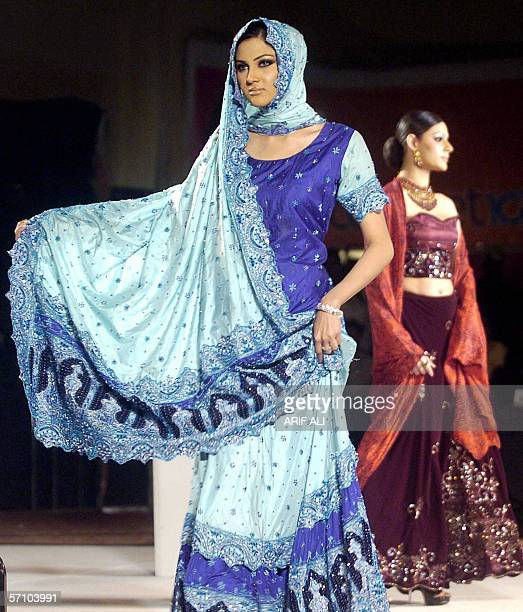 Pakistani models display sarees during a fashion show in Lahore 16 March 2006 The event was organised by the Dubaibased Kamber Entertainment Group in...