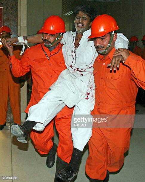 Pakistani paramedics of the Civil Aviation Authority take in an evacuation exercise at a terminal of the Allama Iqbal Airport in Lahore 18 December...