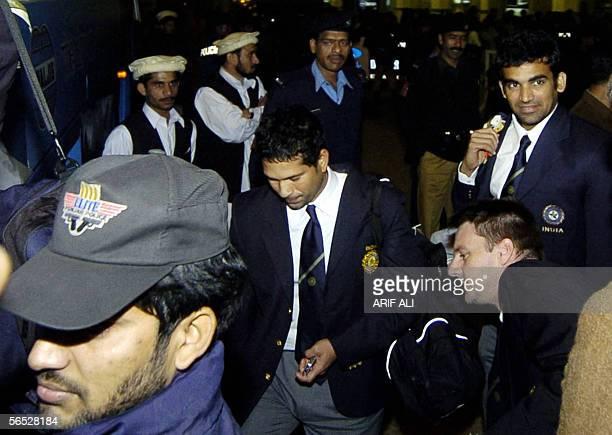 Pakistani police commandos escort Indian cricket team players Sachin Tendulkar and Zaheer Khan arriving at Allama Iqbal international airport in...