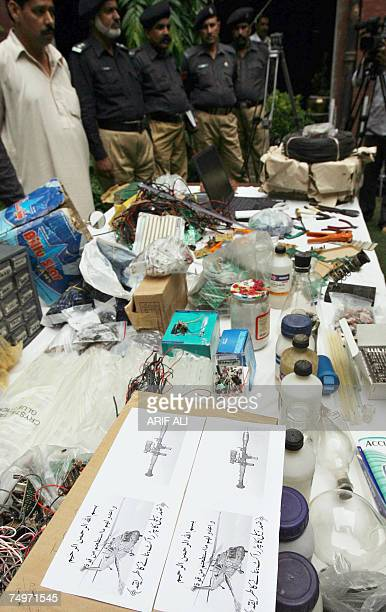 Pakistani policemen stand in front of remotecontrolled explosive devices seized from Islamic militants in Lahore 01 July 2007 Pakistani intelligence...