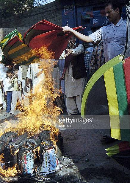 Pakistani protesters burn kites during a protest against the use of metal strings in kite competitions at the Basant festival in Lahore 07 March 2006...