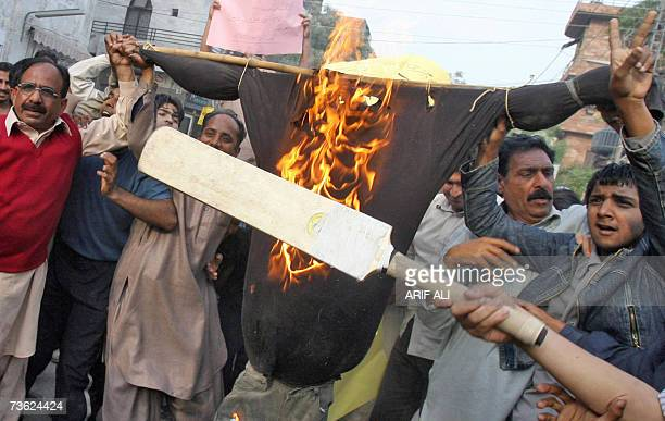 Pakistani protesters hold a burning effigy of cricket team captain Inzamam-ul-Haq during a demonstration in Lahore, 18 March 2007. The Pakistan...