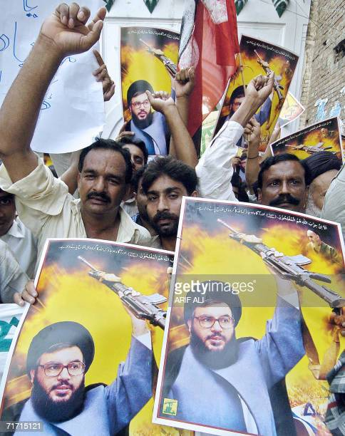 Pakistani Shiite Muslims carry pictures of Hassan Nasrallah head of the Lebanese Shiite militant group Hezbollah during an antiIsrael protest rally...