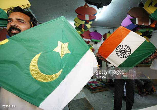 Pakistani shopkeepers display Pakistani and Indian flags printed on kites to attract customers on the eve of the annual kiteflying Basant Festival in...