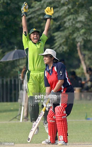 Pakistani wicketkeeper Batool Fatima makes an appeal for a successful catch off Hong Kong batswoman Renee Ravi Montgomery during the second match of...