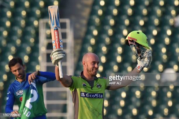 Lahore Qalandars Chris Lynn celebrates after scoring a century during the Pakistan Super League T20 cricket match between Lahore Qalandars and Multan...