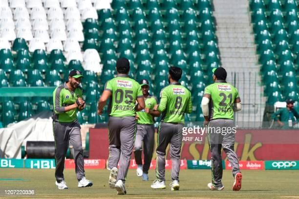 Lahore Qalandars players celebrate the wicket of Multan Sultans Zeeshan Ashraf during the Pakistan Super League T20 cricket match between Lahore...