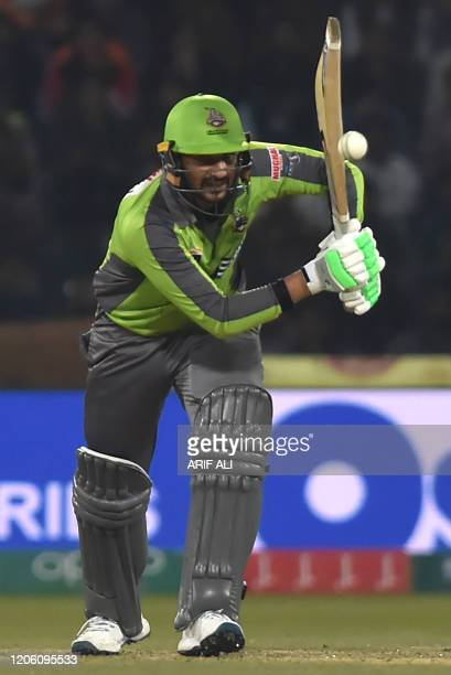 Lahore Qalandars's Sohail Akhtar plays a shot during the T20 cricket match between Karachi Kings and Lahore Qalandars at the Gaddafi Cricket Stadium...
