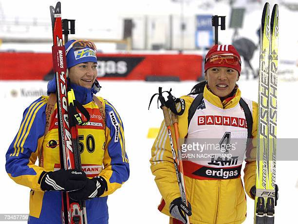 Chinese Xianying Liu fifth placed stands next to overall World Cup leader Anna Carin Olofsson after the IBU Women 15 km Biathlon in Lahti 28 February...