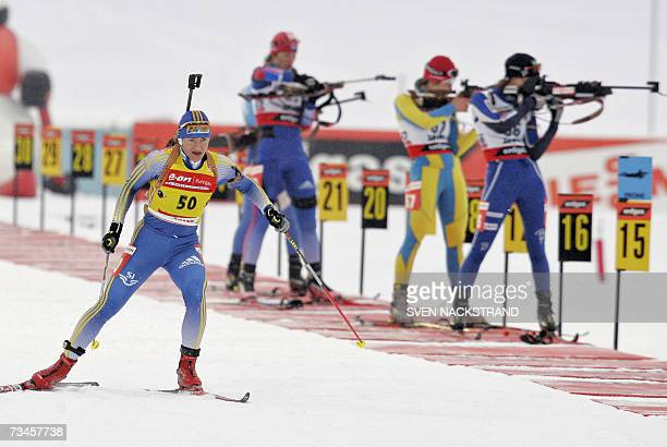 Overall World Cup leader Swede Anna Carin Olofsson leaves a shooting to a fourth place in the IBU Women's 15 km Biathlon in Lahti Finland 28 February...