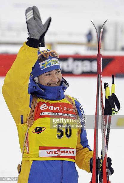 Overall World Cup leader Swede Anna Carin Olofsson waves after her fourth place in the IBU Women's 15 km Biathlon in Lahti Finland 28 February 2007...