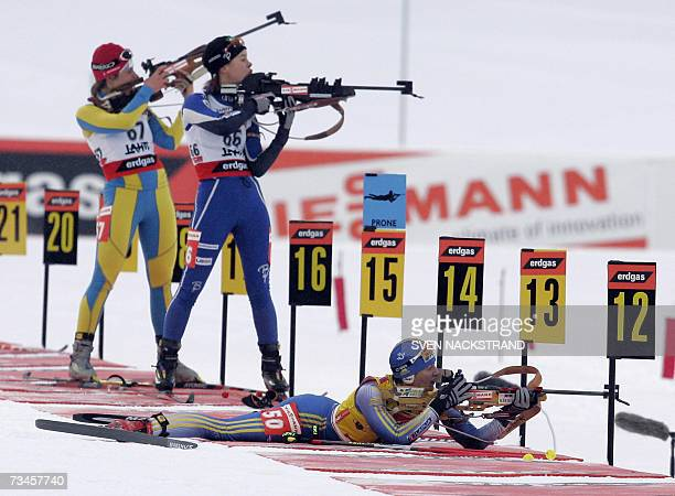 Overall World Cup leader Sweden's Anna Carin Olofsson shoots in a prone position as she competes to place fourth in the IBU Women's 15 km Biathlon in...