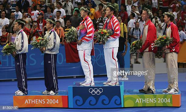 Lai Chak Ko and Ching Li of Hong Kong , Ma Lin and Qi Chen of China and Michael Maze and Finn Smirnov of Denmark stand on the podium during the medal...