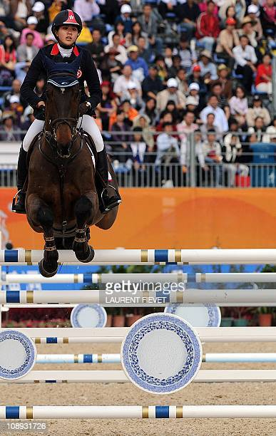 Lai Jacqueline JingMan of Hong Kong riding Capone 22 competes in the equestrian jumping team event at the 16th Asian Games in Guangzhou on November...